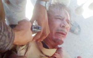 ثوار سوريا يوزعوا فيديو جديد لعملية قتل القذافي ويتوعدوا بشار بمصير مشابه