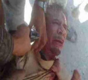 المجلس الانتقالي يعد بمحاكمة قتلة القذافي